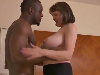Big-Chested mature gal takes a giving dark-hued jizz-shotgun