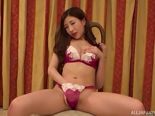 Japanese solo model Aise Kurara puts her hands in her tiny thong