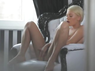 A hot beauteous is tweaking her cunt lips with her feet really unstintingly